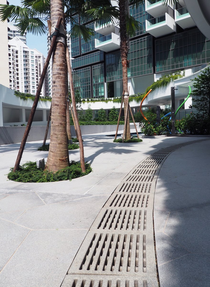Jonite trench grates industrial design in commercial mixed use building 8 St Thomas Singapore