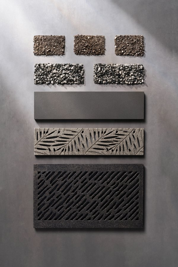 Decorative reinforced stone custom grates and panels